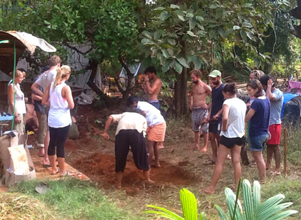 PDC students hard at work, making a grey water mulch pit.